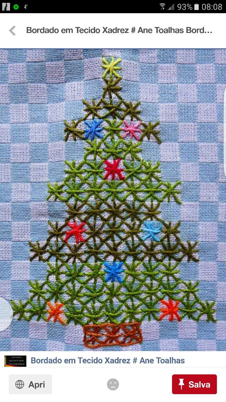 Decorated Christmas tree cross-stitched on checked fabric...sort of chicken-scratch or tenerife style