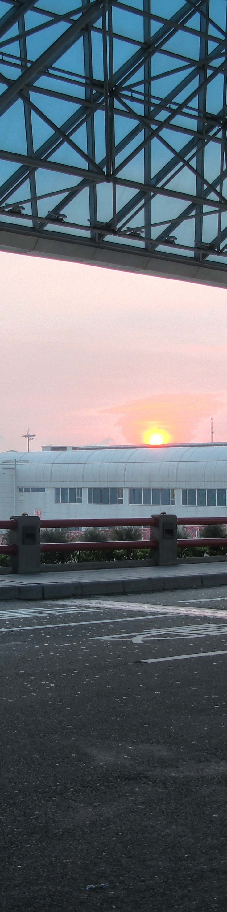 TPE—sunset from Terminal 2 of Taiwan Taoyuan International Airport, taken shortly before boarding our flight back to Hong Kong.