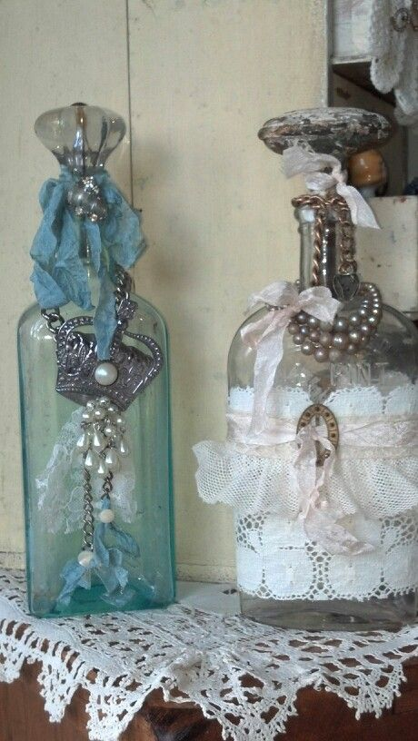 Repurposed bottles with flea market jewelry:
