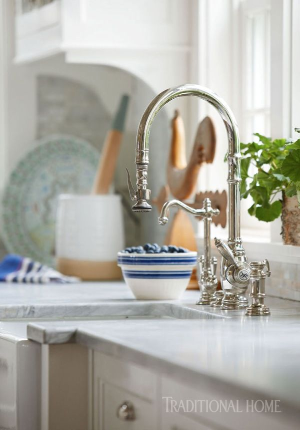 A Waterstone faucet adds timeless appeal to this Nantucket kitchen. - Photo: Michael Partenio / Design: Nancy Serafini