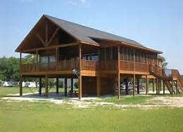 Best 25 house on stilts ideas on pinterest tiny beach Log cabin homes on stilts