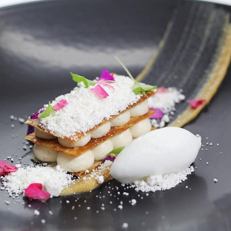 Banana Coconut Napoleon - banana diplomat, banana caramel sauce, caramelised filo, coconut sorbet and coconut snow. ✅ By - @bachour1234 at @savourschool ✅ #ChefsOfInstagram www.ChefsOF.com