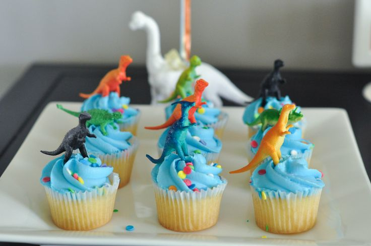 A Modern Dinosaur Birthday Party (NO DIY Needed!). Store-bought cupcakes that Bodhi picked out (blue frosting, anyone?) were topped with small dinosaurs that I ordered from Amazon.