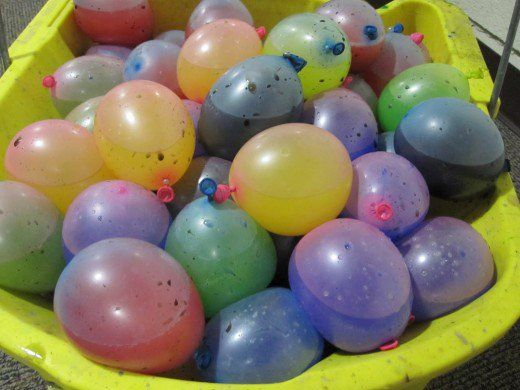 This is a summer party idea that involves a lot of paint and a lot of fun!