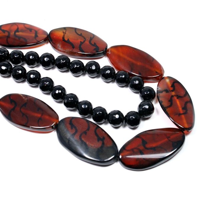 Amber coloured veined agate slabs and faceted black onyx
