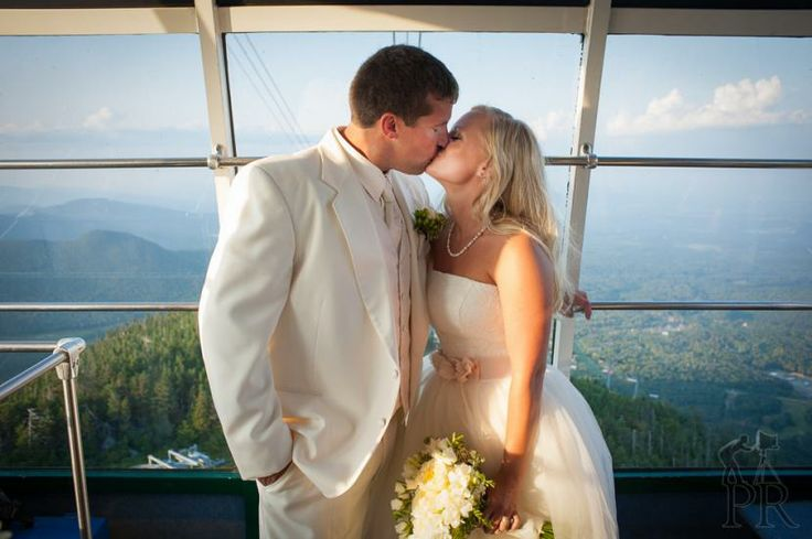 Weddings at Jay Peak | Jay Peak Resort - Newlyweds taking the aerial tram to Elevation 4000 summit for photographs. Check out the view in the background.