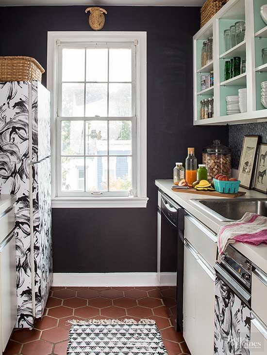 If ugly appliances have your rental kitchen in a sad state, consider covering them with contact paper. The easy-to-apply adhesive comes in many patterns and colors, and it can be removed or replaced as needed. If you're able to paint your apartment, try a new shade on the inside of cabinets for a subtle hint of color./