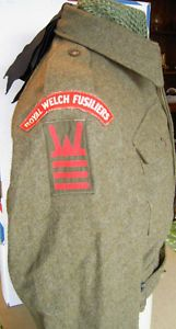 World War Two Battle Dress tunic from 6 RWF,160 Bde, 53rd (Welsh) Division showing the Flash and the Div/Bde TRFs.