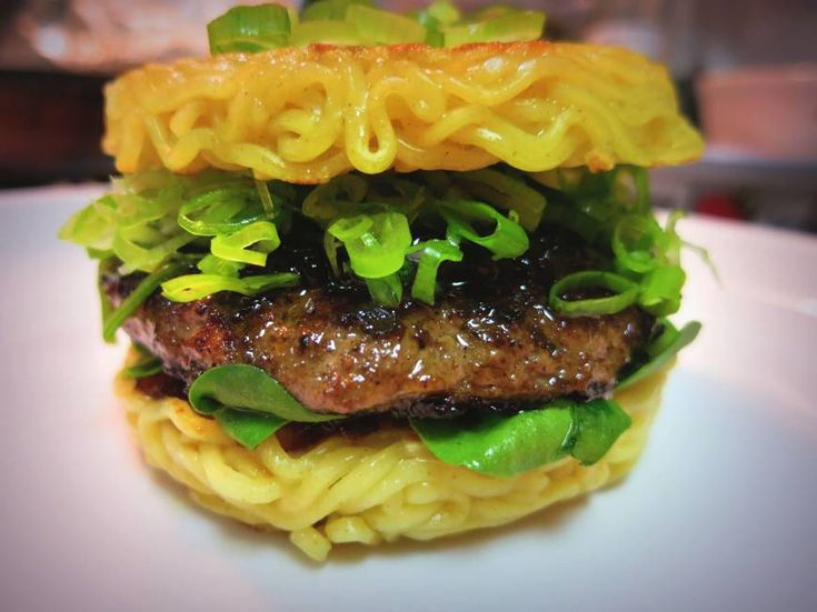 Ramen Burger, japantimes.co.jp: In Japan the dish is most closely associated with the hinterlands of Fukushima Prefecture. Noodles envelop a pork filling and such ramen toppings as naruto (fish cakes) and menma (bamboo shoots), drizzled with a soy-flavored sauce.