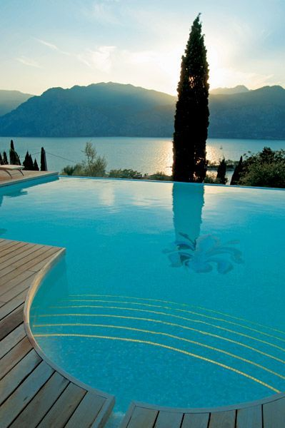 Hotel Bellevue San Lorenzo, Lake Garda, Italy. The most amazing view from the pool and restaurant. And a great Michelin Restaurant close by in Malcesine
