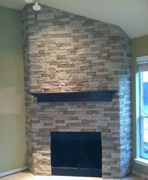 Airstone.  lightweight stone like finish.  I think this should work for the fireplace install.