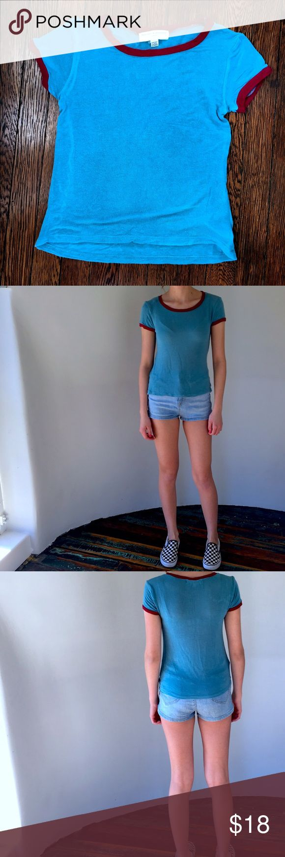 Urban outfitters Project Social T Molly Ringer tee It's a blue (almost green) tee shirt with red on the sleeve and neck lines. There is a spot that looks lighter than the rest but it came that way and it still looks great! It's made from stretchy material. I only wore it once and it's in great condition! Urban Outfitters Tops Tees - Short Sleeve