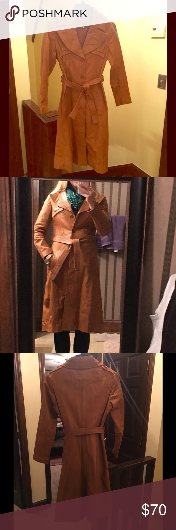 Real leather camel brown trench coat A gorgeous vintage piece in excellent vintage condition, perfect for that winter boho look! A few small spots but faint and not noticible when wearing the garment.  A gorgeous vintage treasure! Hits below the knee.  Listed as a vintage 7/8 but would best fit a 0 to small 4 Vintage Jackets & Coats Trench Coats
