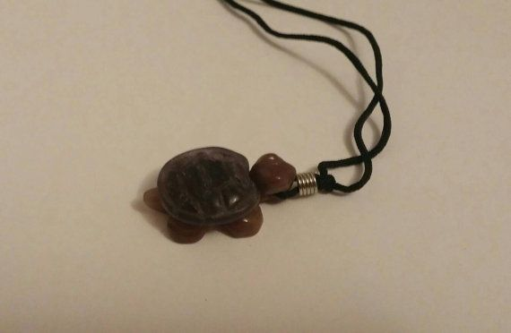 Check out this item in my Etsy shop https://www.etsy.com/ca/listing/505533553/nephrite-jade-turtle-charm-necklace