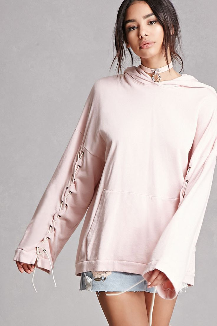 A French terry hoodie by Private Academy™ featuring long boxy dropped sleeves with a lace-up design, a kangaroo pocket, and an oversized silhouette.