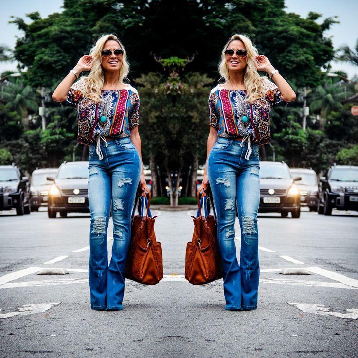 Calça jeans flare rasgos cintura alta