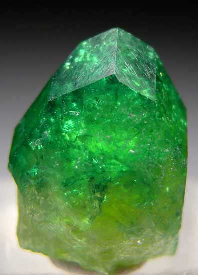 Chrome Vesuvianite. Translucent to transparent complete single crystal with bright emerald green coloration. Crystal is undamaged.