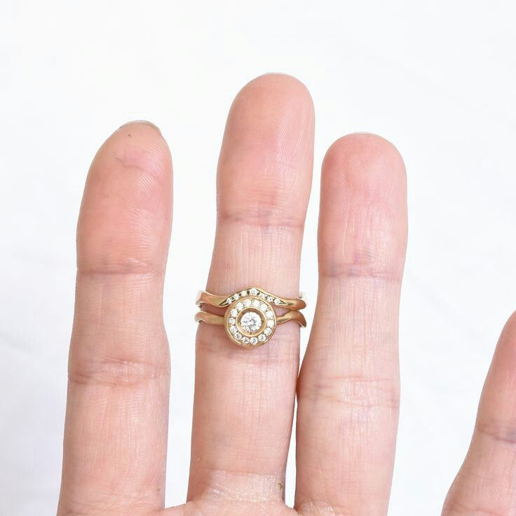 Diamond circle engagement ring from rose gold. Classic ring with original touch.