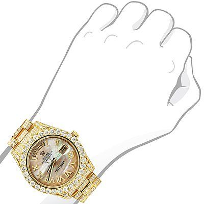 This breathtaking 18K Gold Oyster Perpetual Iced Out Rolex Diamond Watch for Men features 20 carats of sparkling genuine diamonds masterfully set in a shiny 18K gold bezel, case and band. This Gold Rolex Mens Diamond Watch showcases a yellow mother of pearl dial with Roman numerals decorated with dazzling diamonds and a date display at the 3 o'clock position. This custom Rolex diamond watch is pre-owned, in excellent condition and comes with original Rolex box a full year warranty from It...
