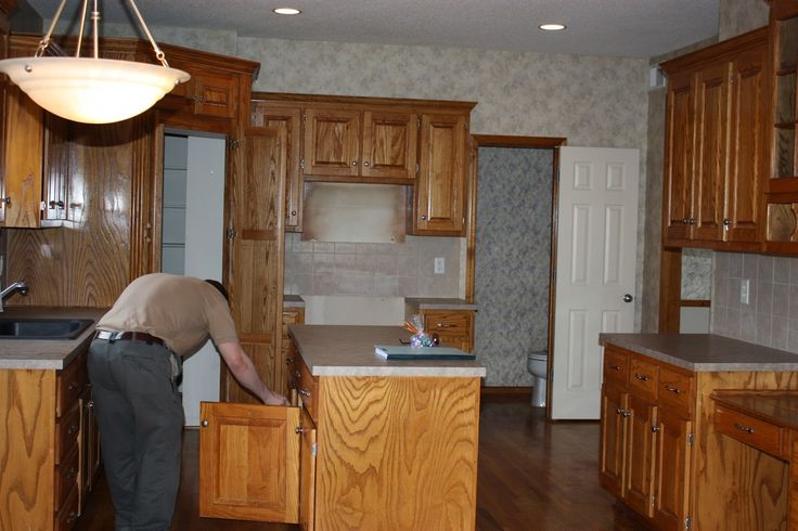 Oh So Lovely: OUR $500 DIY KITCHEN REMODEL (painting cabinets white without sanding)