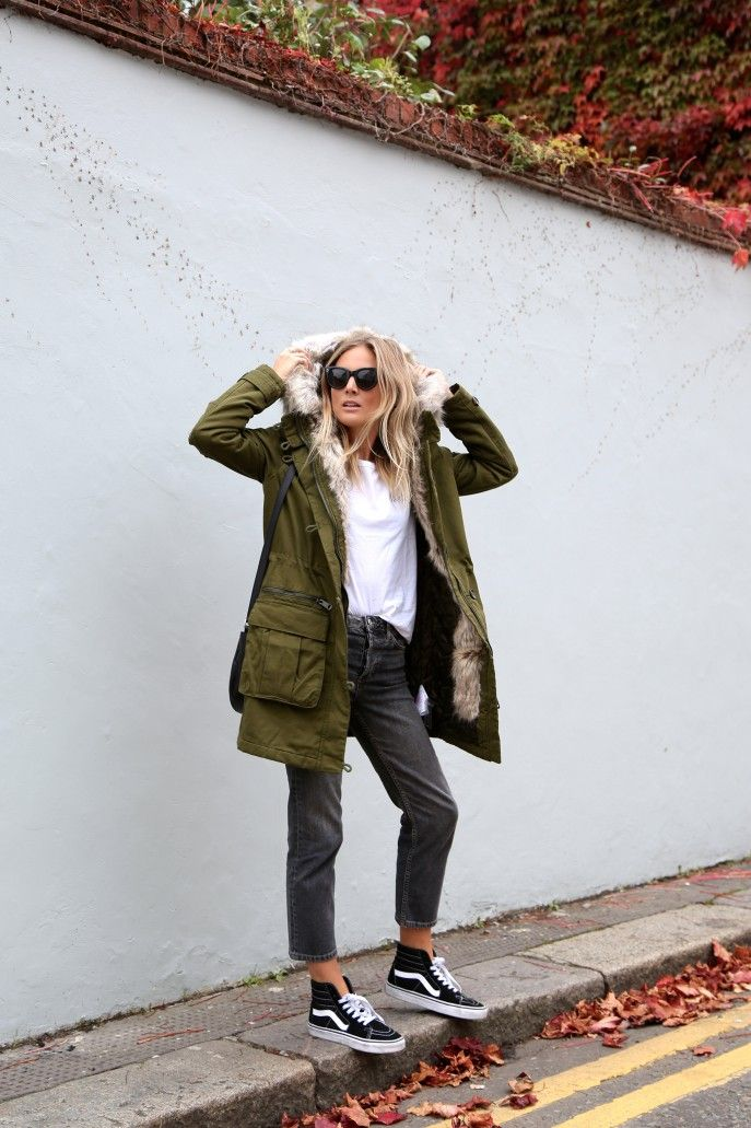 Lucy Williams shows us how to wear the Parka trend, pairing this khaki jacket with black mom jeans and sneakers. Parka: Topshop, T-Shirt: Maison Labiche via Sezane, Jeans: Topshop, Trainers: Vans.