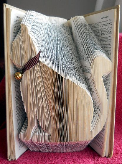 Book folding pattern for a Cat  on Craftsuprint designed by Lyndsey Houghton - made by Gail Pennycuick - I printed the pattern out and started marking the book pages, having checked the correct size needed. Next I started on the folding and watched as the cat began to emerge. Finally I attached a lightweight ribbon and bell across the cat's neck. This is a great design for cat lovers. - Now available for download!