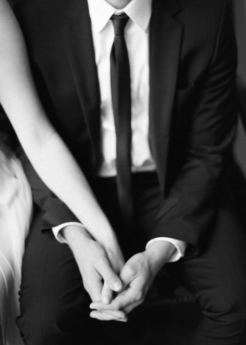 Holding hands. Love when the small details are captured.