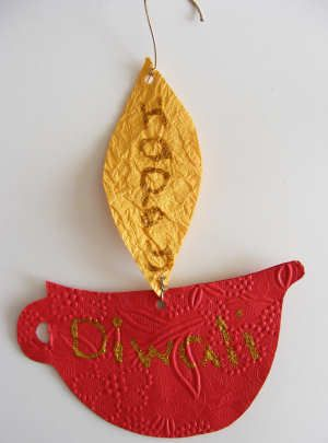 Diwali -- Diya Mobile from 2 different colour paper - write Happy Diwali and hang to welcome others