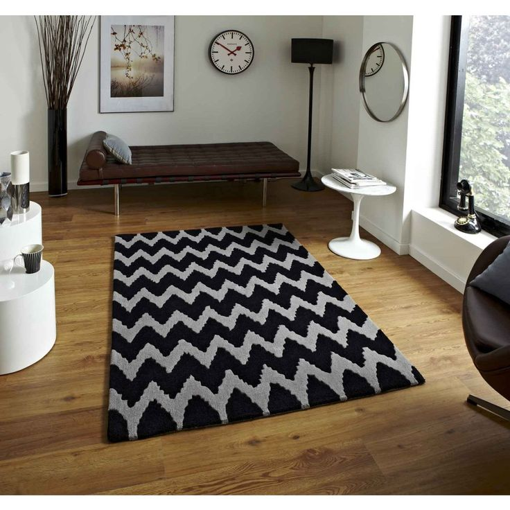 Hong Kong HK-867 Black Grey Rug By Think Rugs Hong Kong HK-867 Black Grey Rug which is an offering from Think Rugs, is a brilliant home décor accessory featuring modern zigzag patterns in two sophisticated colours of grey and black. #handmaderugs #modernrugs #stripedrugs #abstractrugs
