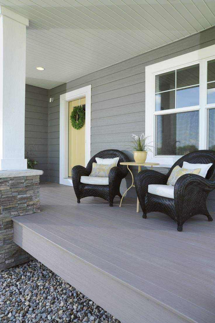 Beautiful porch with AZEK decking Arbor Collection in Silver Oak.
