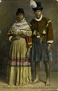 """Seminole Couple, 1895.  The Seminole are originally from Florida. Today, most Seminole live in Oklahoma; there are three federally recognized tribes and independent groups. The Seminole nation emerged out of groups of Native Americans, most significantly Creek from what are now northern Florida, Georgia, and Alabama, who settled in Florida in the early 18th century. The word Seminole is a corruption of cimarrón, a Spanish term for """"runaway"""" or """"wild one."""""""