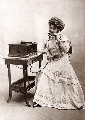Woman on the Phone. 1907 Wow! Look at the size of that telephone!