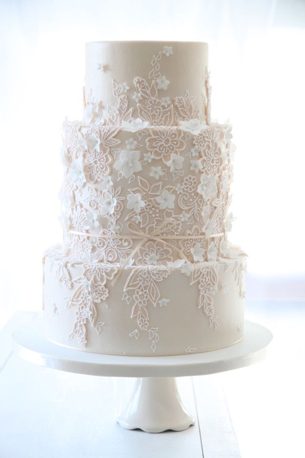This understated cake with an intricate lace design.   24 Wedding Cakes That Made 2016 So Much Sweeter
