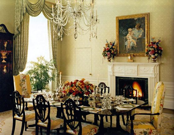 Luxury Dining Room With Glass Table Chairs Flowers Fireplace And