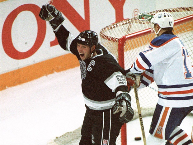 NHL Point Leader: LA Kings centre Wayne Gretzky celebrates as he scores his 1,851st point, breaking Gordie Howe's record in Edmonton on October 15, 1989.