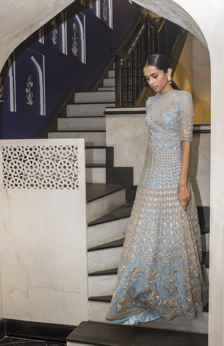 The model in a vintage blue net gotapatti embroidered cocktail gown.