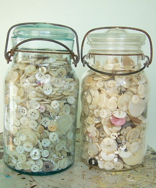 old jars of old buttons  http://sweetmeas.blogspot.com/2011/08/use-93-for-old-mason-jar-button-storage.html
