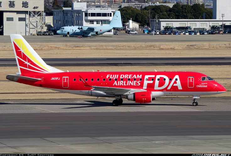 Fuji Dream Airlines-FDA (JP) Embraer ERJ-170 JA01FJ aircraft, with the sticker ''The Spirit of Chateraise Natural Sweets & Gifts'' on the airframe, skating at Japan Nagoya Airfield (Komaki airport). 03/02/2015. (The Bright Red colored plane).