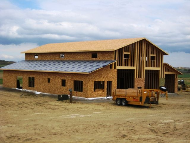 Horse barns with living quarters framing up two story for Shop with living space