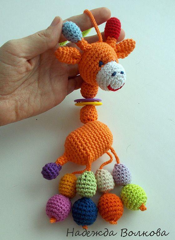 ... решила для них, что нибудь связать и вот родился такой оранжевый жирафик. Это моя первая погремушка, ростиком 24 см(без колечка). Туловище-контейнер из под киндера-звенит, в хвостике, лапках, шее бусинки, ... об друга. Сама довольная, как слон, прям заряд позитива получила, связался на одном дыхании) Надеюсь малышу Севушке жирафик придется по вкусу) Теперь хочу и своему пузожителю кого-то подобного ...