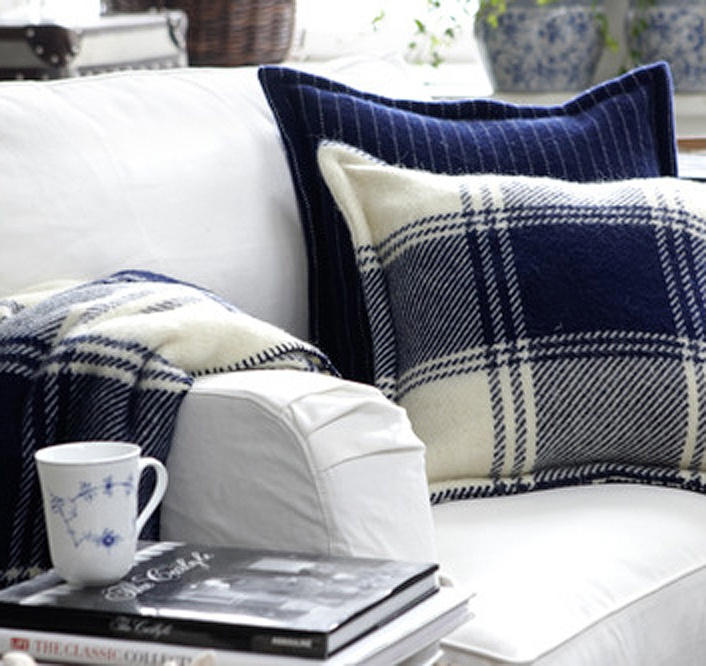 Plaid throw and pillow in blue and white makes for a refreshing, clean look.