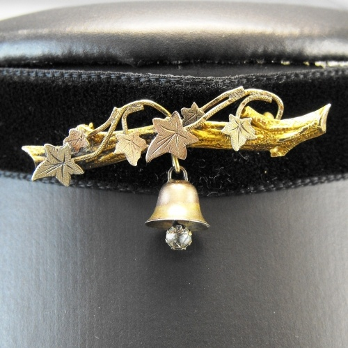 Exquisite 9ct gold brooch made by Arthur Johnson Smith of Birmingham's Jewellery Quarter c.1900.    The brooch is textured in the form of a yellow gold branch, intertwined with ivy leaves of rose and yellow gold. A sweet little bell with crystal bell 'clapper'.  In Victorian jewellery, the use of ivy symbolises everlasting love or marriage.