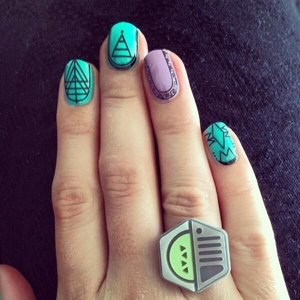 We love Alice's retro futuristic nails with our Spaceship Ring! Get the look now: http://www.tattydevine.com/spaceship-ring-silver.html