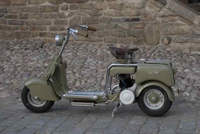 1947 Lambretta 125M (A). Italy. The first Lambretta, produced by Ferdinando Innocenti, a steel-tubing manufacturer. Inspired by the Cushman scooters used by American military during WWII. Innocenti gave the design job to aeronautical engineer, Corradino D'Ascanio, but after a disagreement, design was finalized by aeronautical engineers Cesare Pallavicino and Pier Luigi Torre. D'Ascanio took his design to Enrico Piaggio. The scooter was named for the Lambro River which ran next to the…
