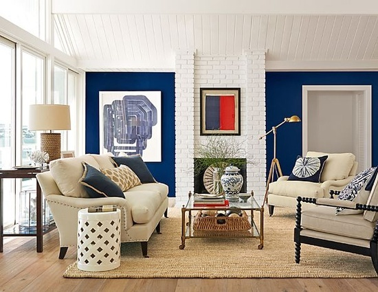 Love the navy wall and painted white brick outside for Living room navy walls