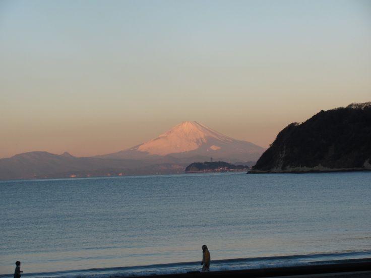 Mt. Fuji and Enoshima. Zushi beach in a winter morning.