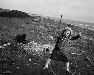 Chris Killip, Helen and her hoola-hoop, Lynemouth, Northumberland, 1984
