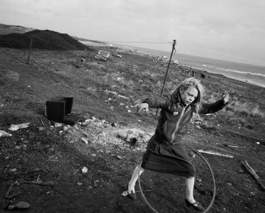 Chris Killip, Helen and her hoola-hoop, Lynemouth, Northumberland, 1984