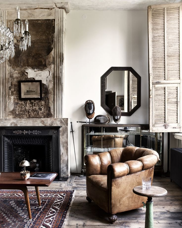 Living room, vintage, interior, design, fireplace, shutters, old wooden floor, reclaimed material, leather chair, eclectic