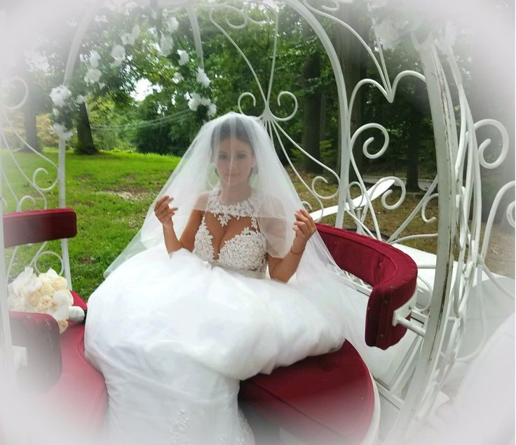 Beautiful bride posing in one of our Cinderella Carriages on the grounds of Oheka Castle, Huntington, Long Island, NY